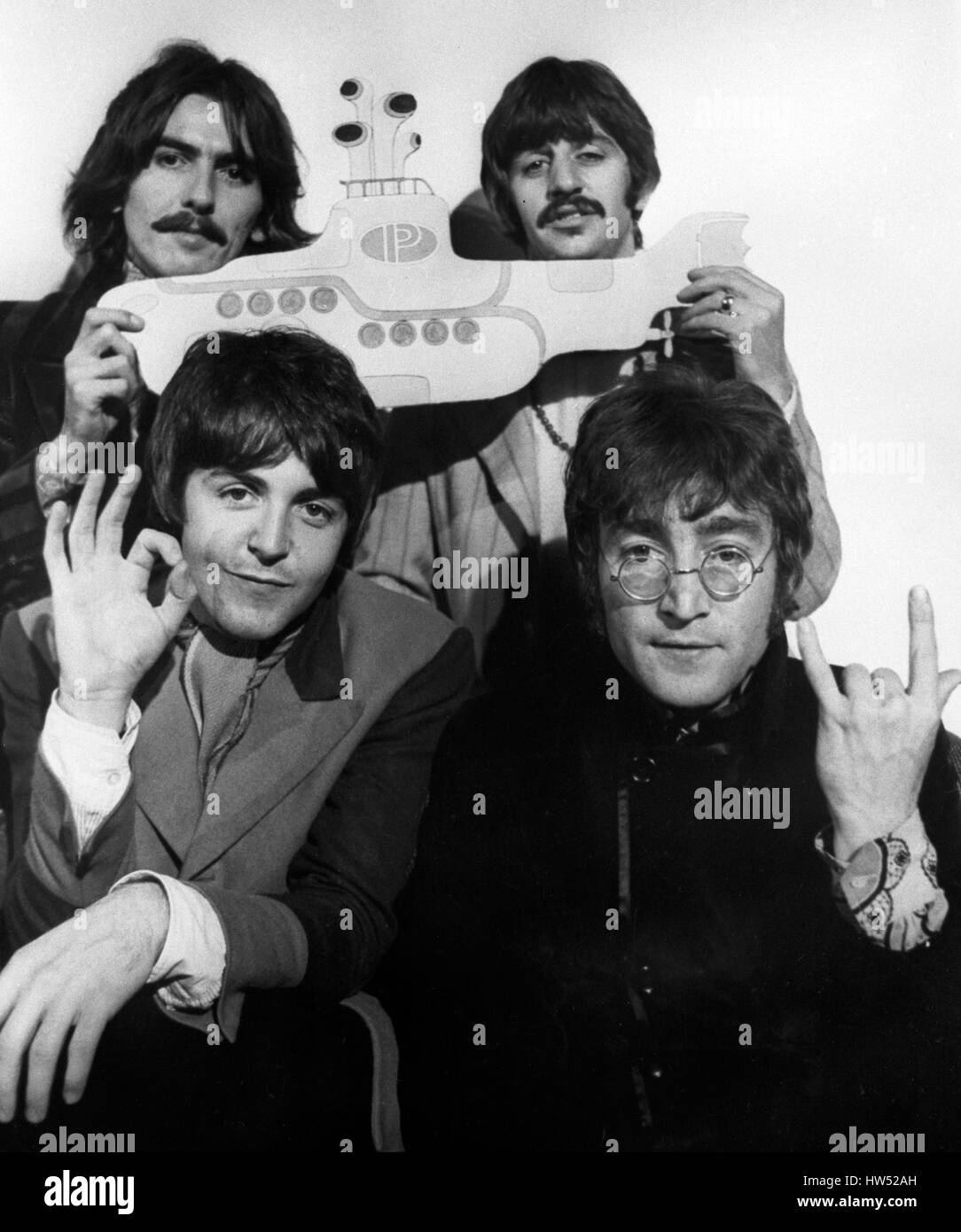 The Beatles George Harrison And Ringo Starr Background L R Paul McCartney John Lennon Front With A Cut Out Of Yellow Submarine