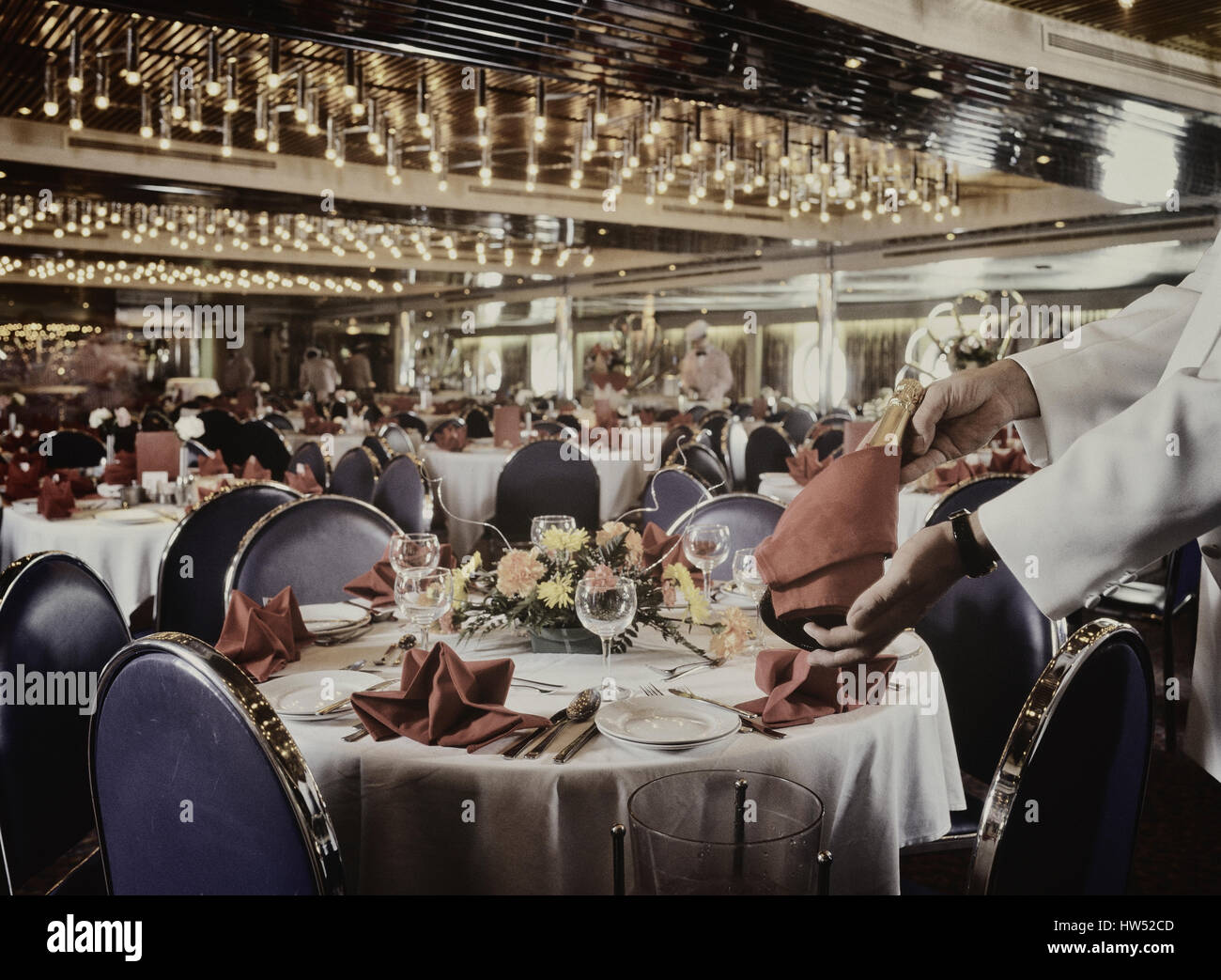 Cruise ship dining room prepared for evening meal. Stock Photo