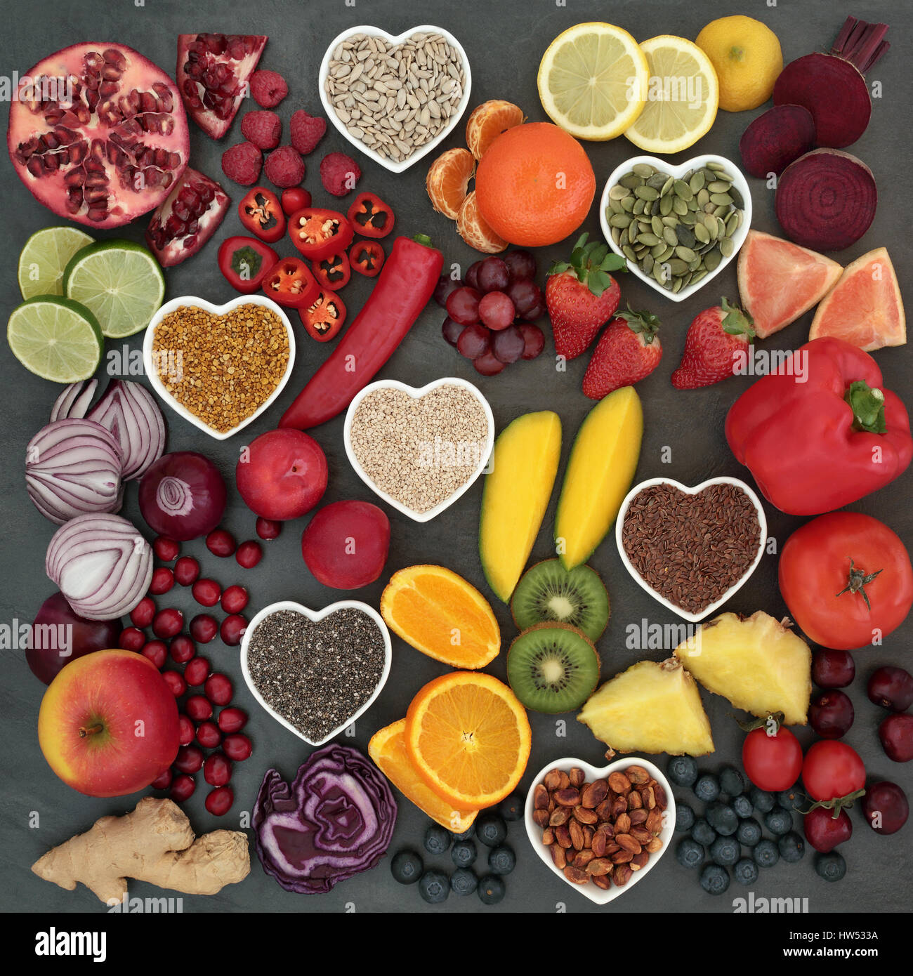 Palaeolithic diet food of fresh fruit, vegetables, nuts and seeds on slate background. High in antioxidants, vitamins, - Stock Image