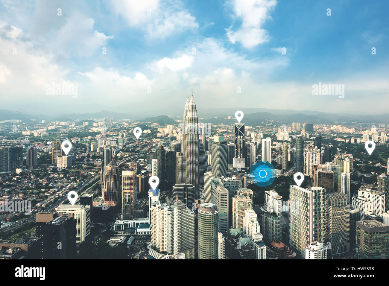 Searching location on map and pin above Kuala Lumpur city and network connection, internet of things, satellite - Stock Image