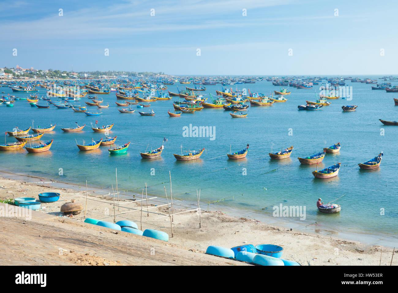 A lot of fishing boats near fisherman village in rural area of Mui Ne, Southern Vietnam. - Stock Image