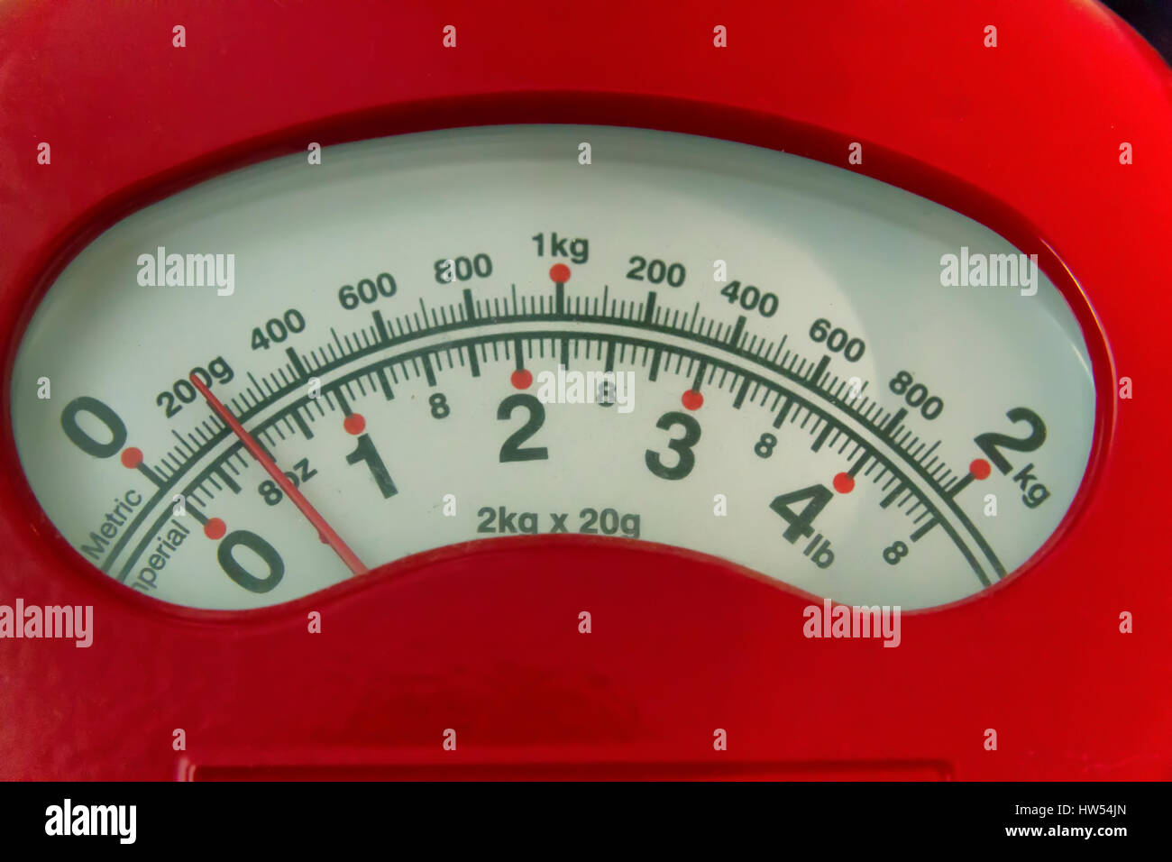 Dial on a set of weighing scales - Stock Image