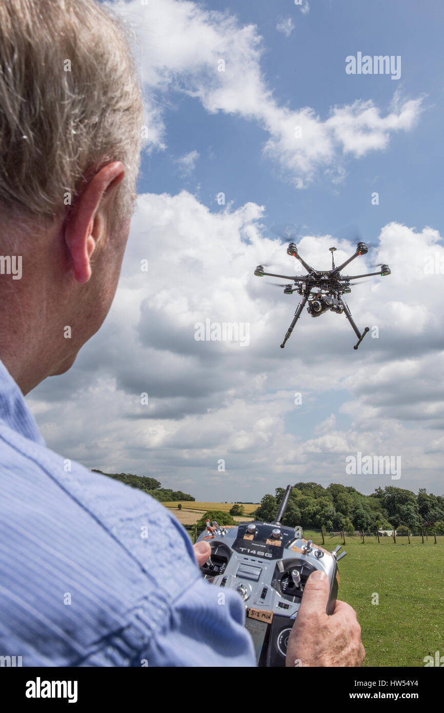 Pilot flying drone - Stock Image