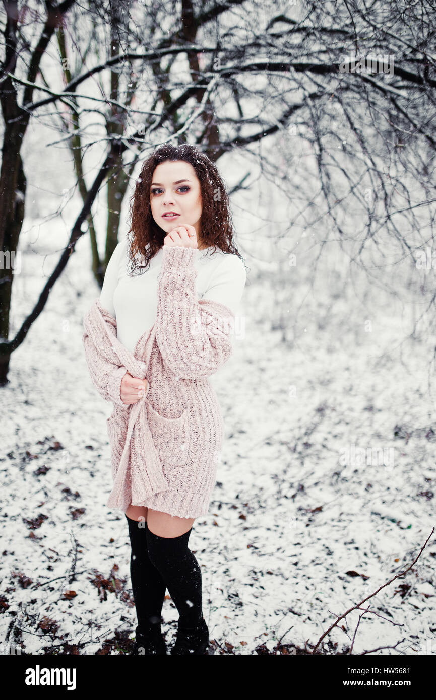 d8572c3f69 Curly brunette girl background falling snow
