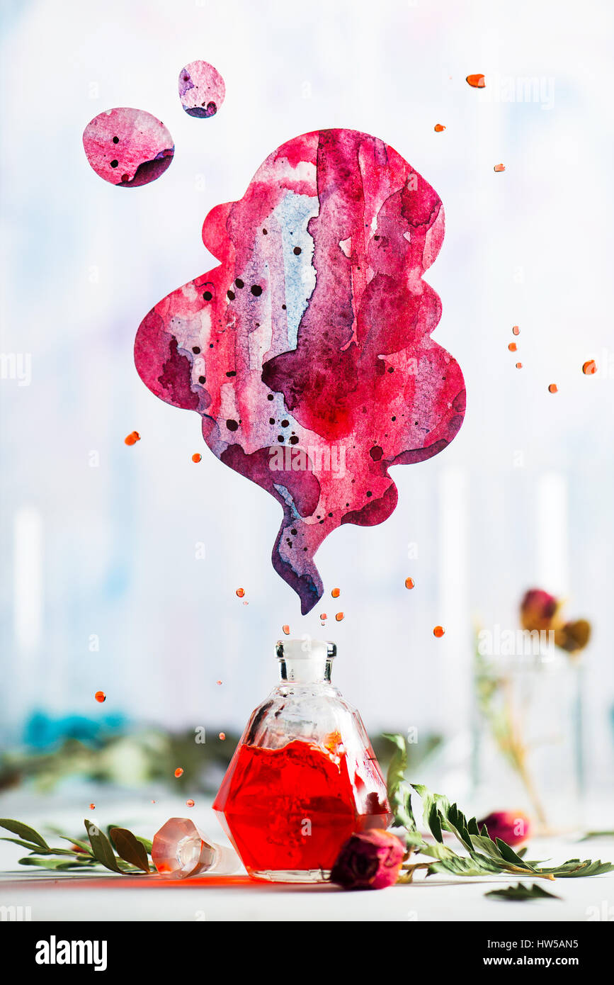 Glass perfume bottle with red liquid and a vibrant cloud of aroma on a white background - Stock Image