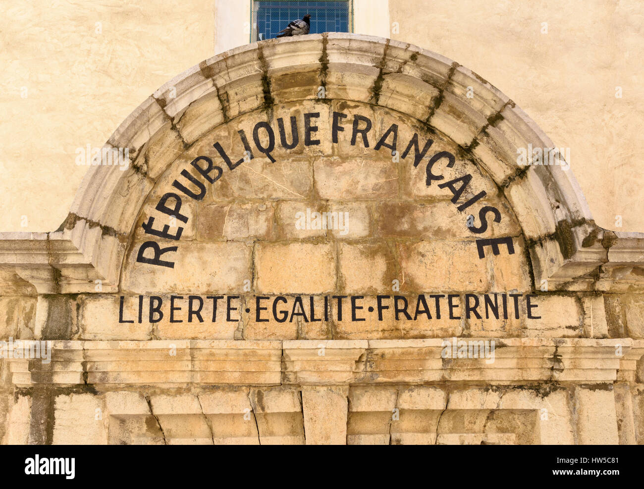 French motto of liberté, égalité, fraternité on a tympanum over the entrance to the Notre Dame - Stock Image