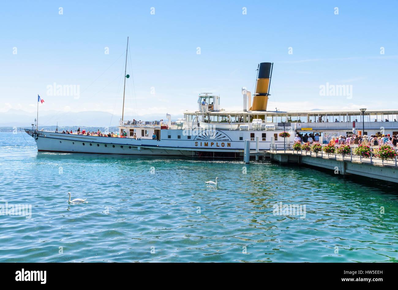Passengers boarding a traditional Lake Geneva paddle steamer at the port of Nyon, Vaud, Switzerland - Stock Image