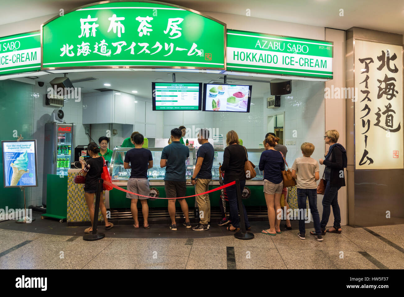 People lining up at a Japanese ice-cream shop on Clarke Quay, Singapore - Stock Image