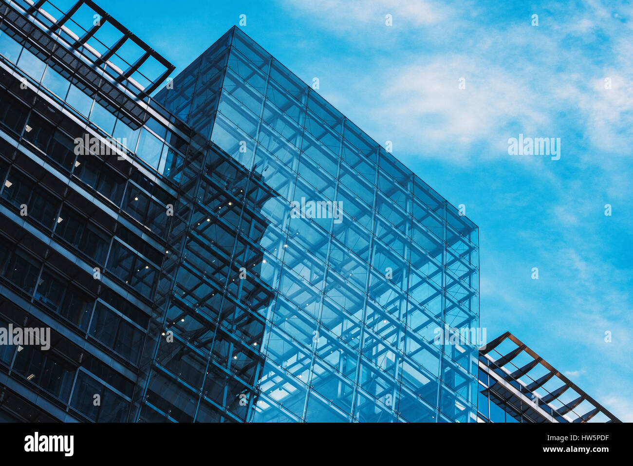 Low Angle View To Light Glass Buildings Of Business Center: Modern Glass Buildings In A Business Area Stock Photo