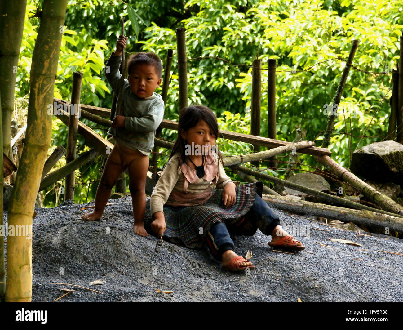 Vietnamese children. National minorities in Sapa. Brother and sister are playing in nature. Sapa, Vietnam, Lao Cai Stock Photo