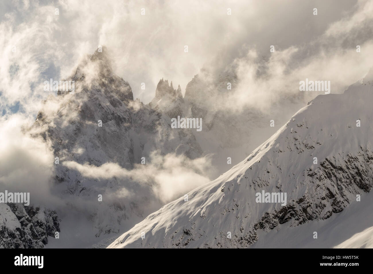 Alps. Cloudy heights of Mont Blanc, Italy. - Stock Image