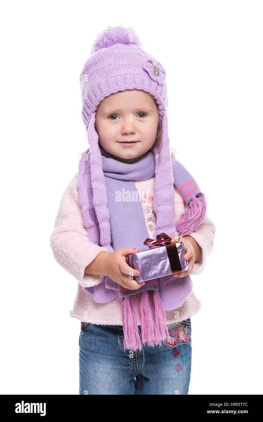 601007bb5 Cute smiling little girl wearing violet knitted scarf and hat Stock ...