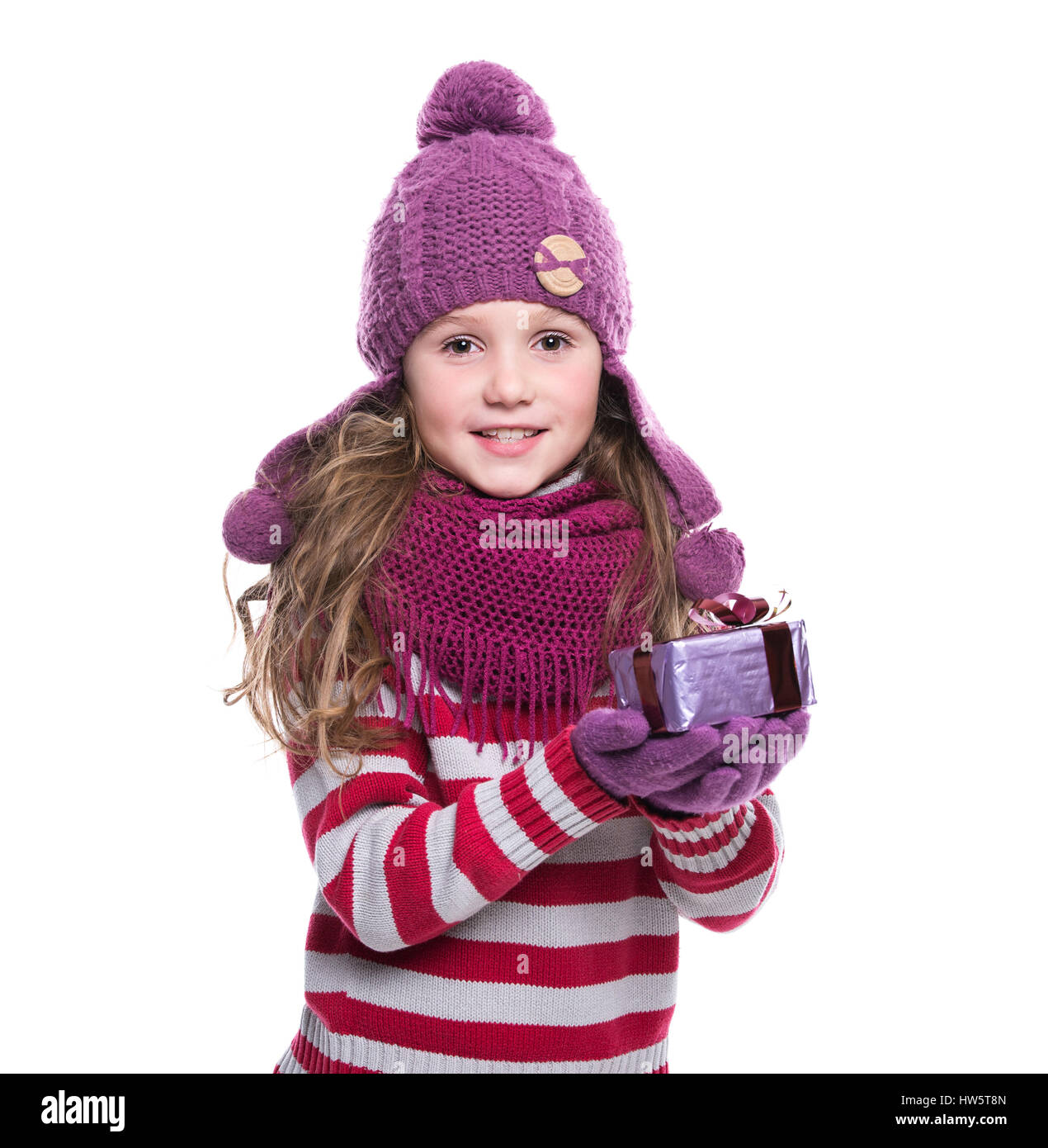 ad9f78b60 Cute smiling little girl wearing purple knitted scarf