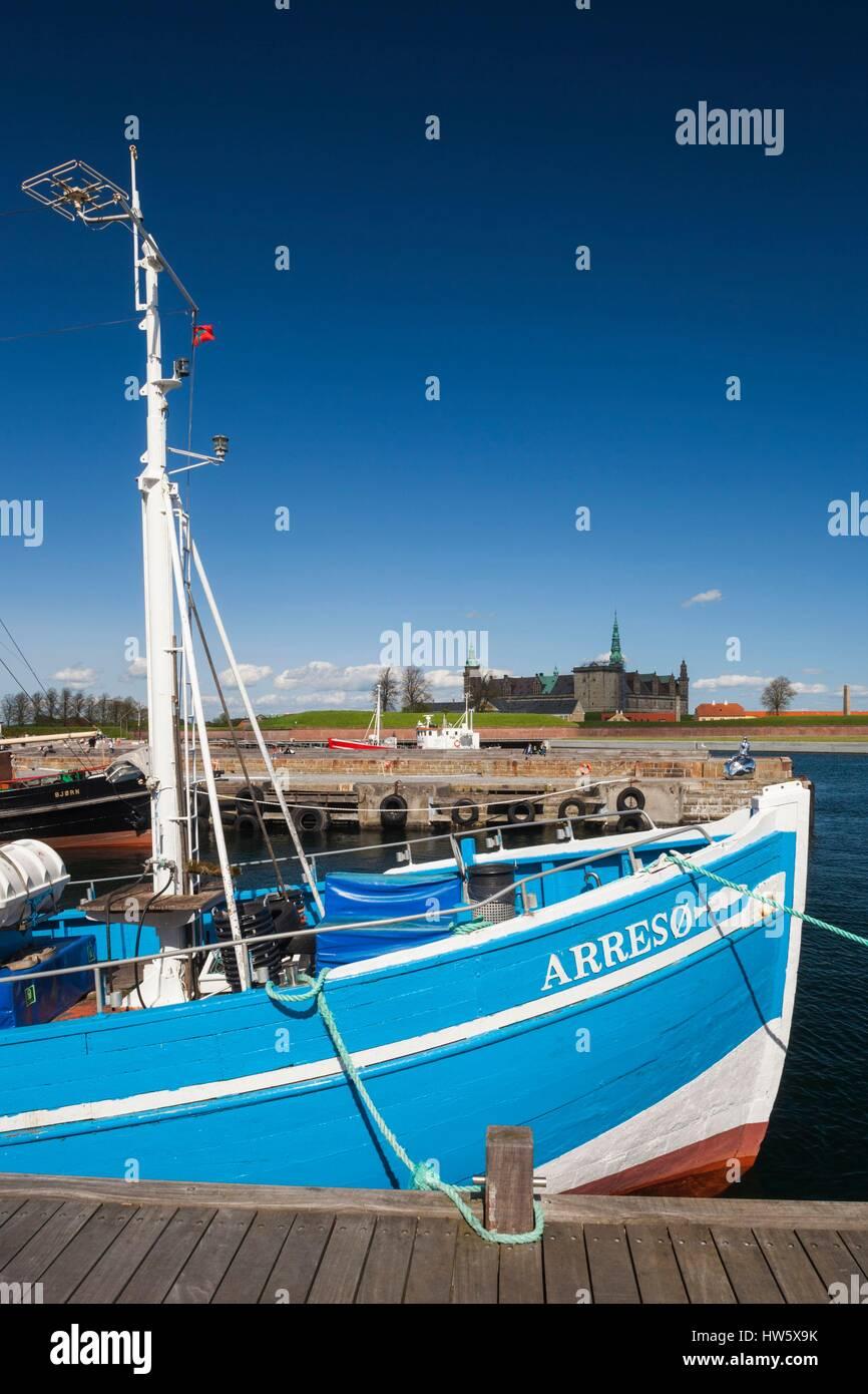 Denmark, Zealand, Helsingor, fishing boat and Kronborg Castle, also known as Elsinore Castle from Shakespeare's - Stock Image