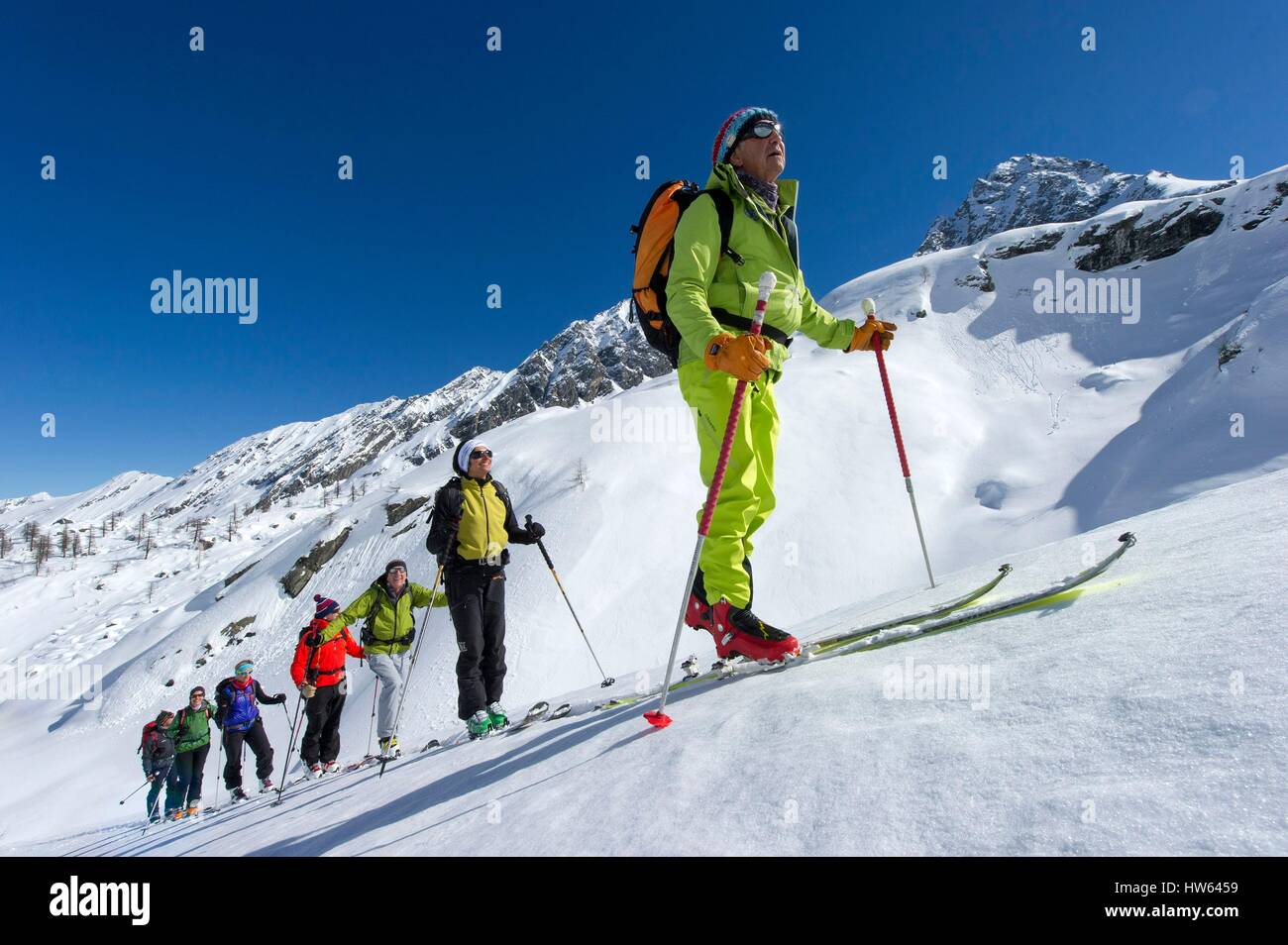 Italy, Piedmont, Val Pellice, group of backcountry skiers led by Yvan Estienne mountain guide amount towards Col Stock Photo