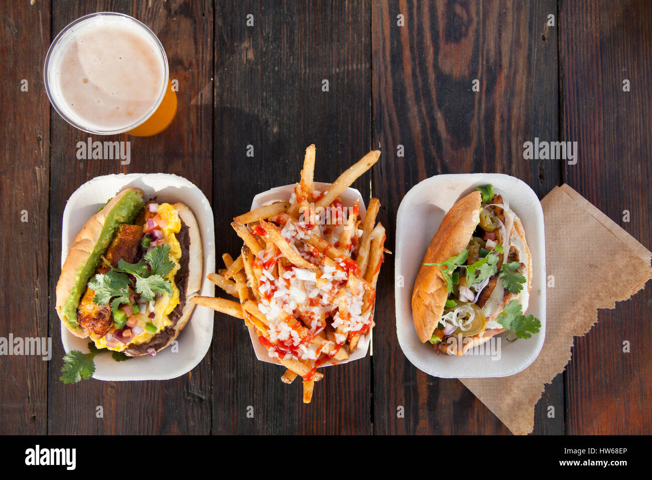 Beer with sandwiches and fries - Stock Image