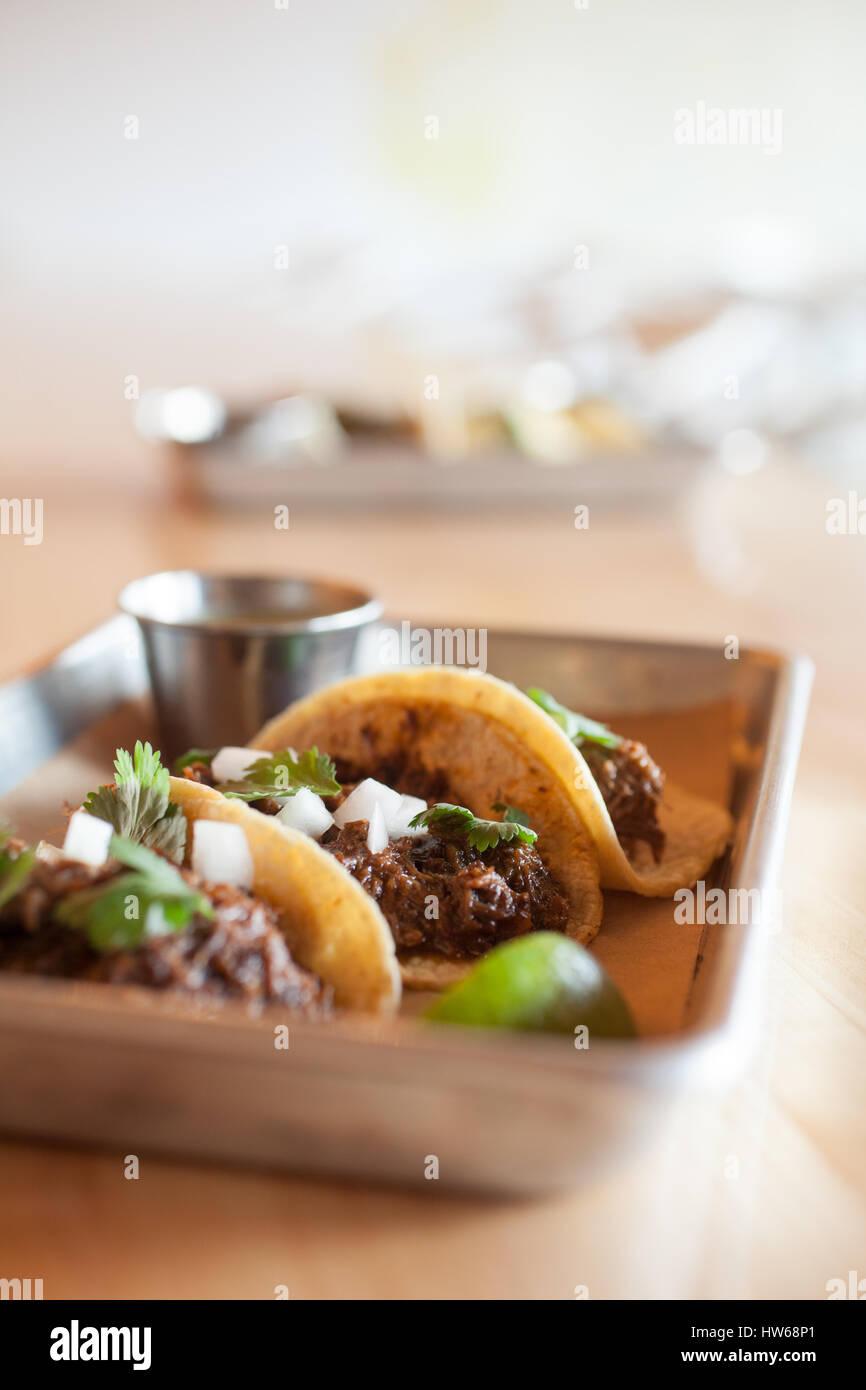 Street Tacos with barbacoa, cilantro, onion, jalapeno salsa on mini corn tortillas - Stock Image