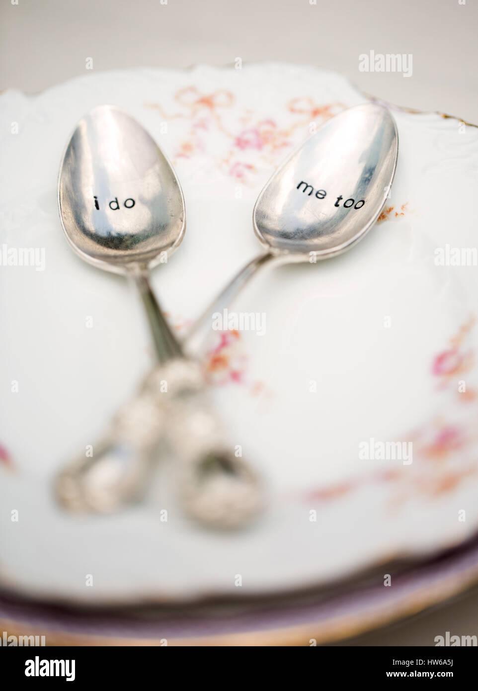 Bride and groom's teaspoons ('I do' 'me too') - Stock Image