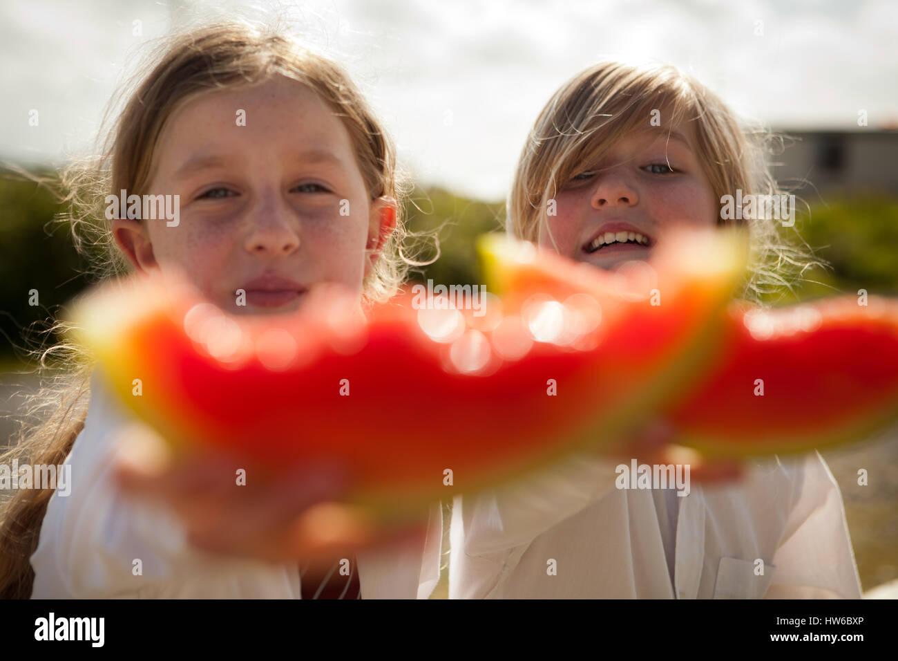 Girls eating watermelon - Stock Image