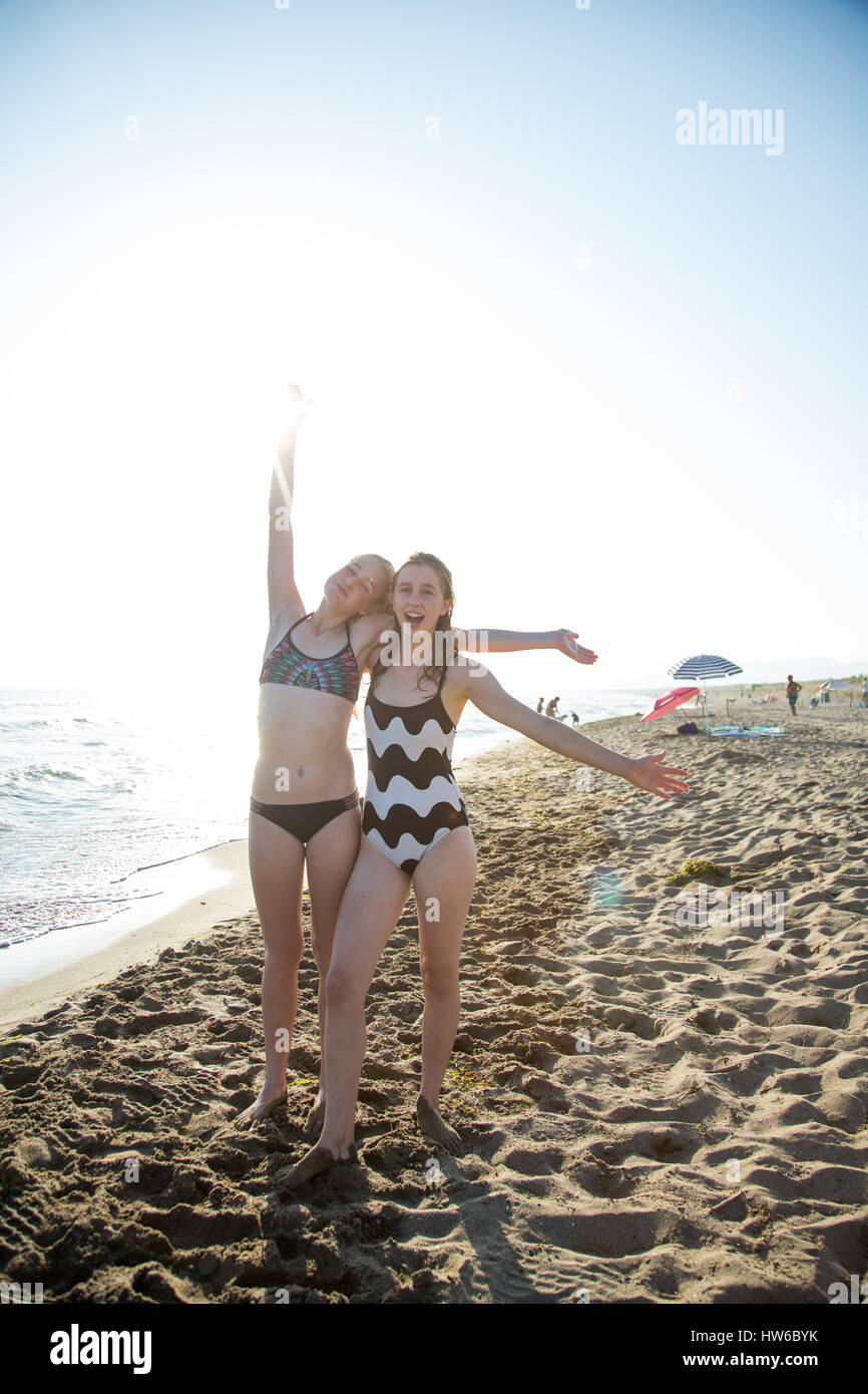 Playful girls on the beach in Italy - Stock Image