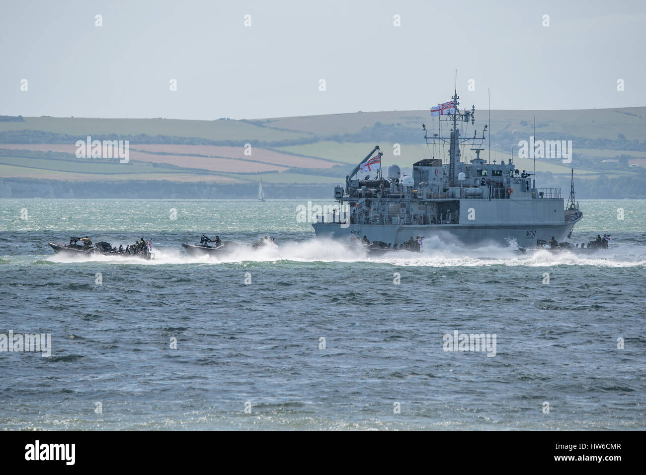 Royal Marines and the Royal Navy mine warfare ship HMS Grimsby in a role demo at the Bournemouth Air Festival, UK - Stock Image