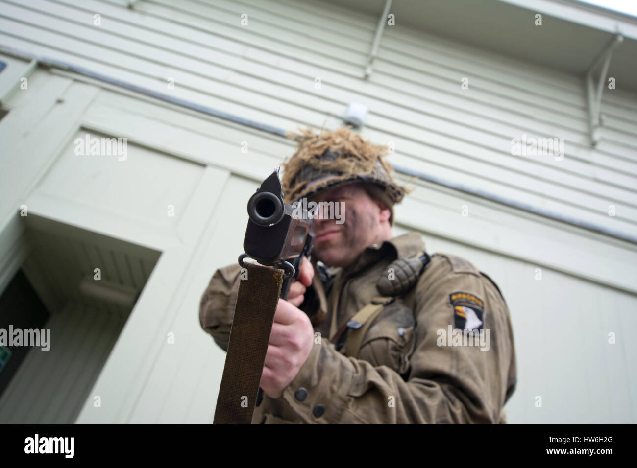 American WW2 Soldier Reinactor with tommy gun pointing at camera at Portsmouth Harbour - Stock Image