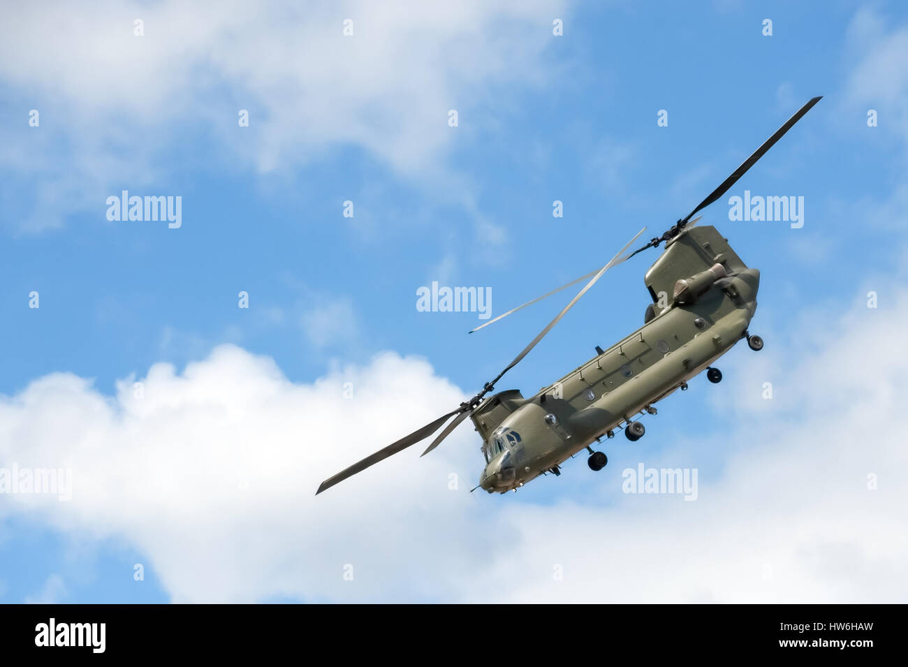 military helicopter in a steep flight maneuver - Stock Image