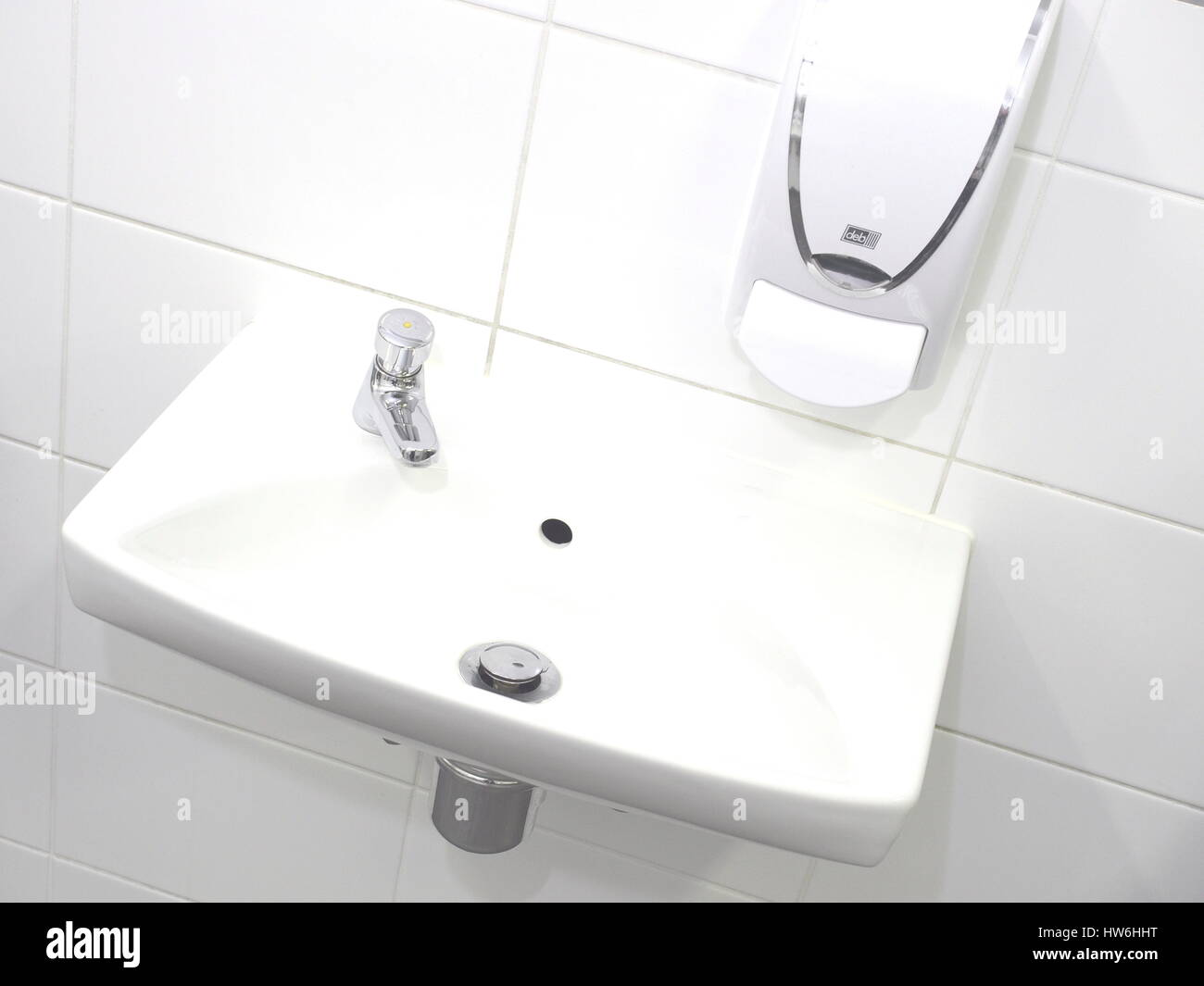 Melbourne, Australia, 2015, August 7: Hand wash basin and spout in a pristine industrial lavatory - Stock Image