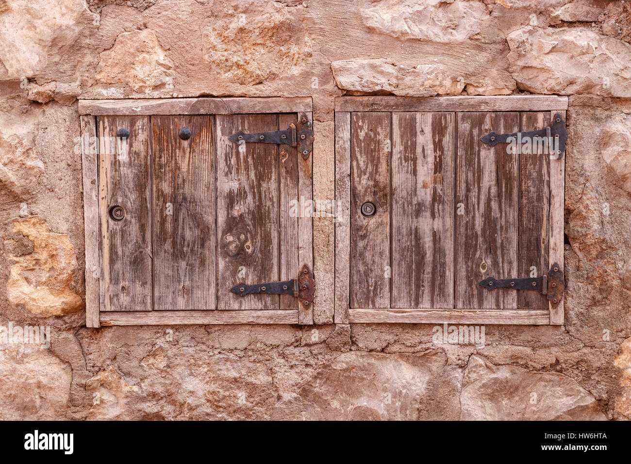 Two wooden hatches in an old stone wall  Albarracin, Spain