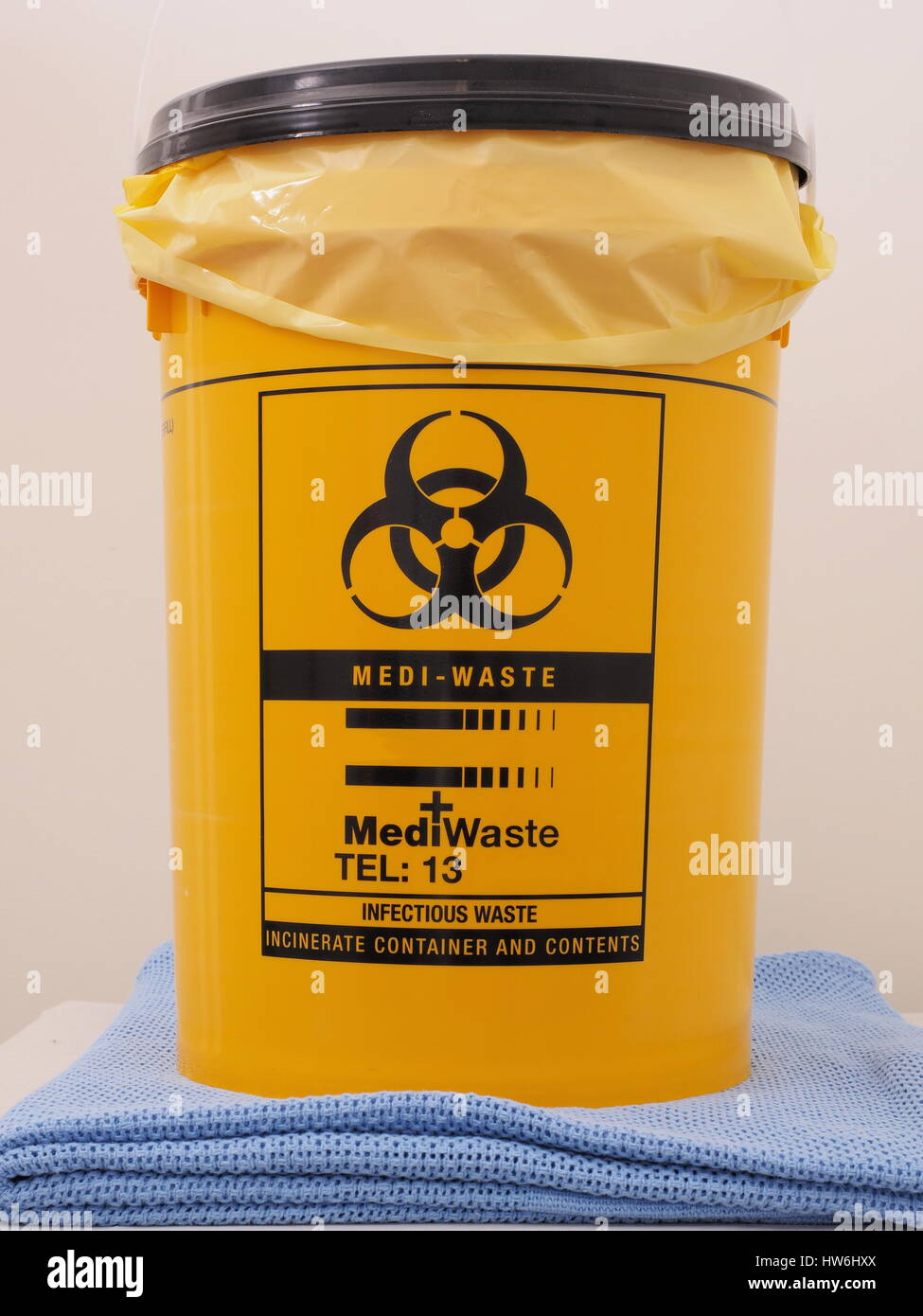 Bio Hazard labled yellow specialist collection container as used in first aid rooms, Melbourne 2015 - Stock Image