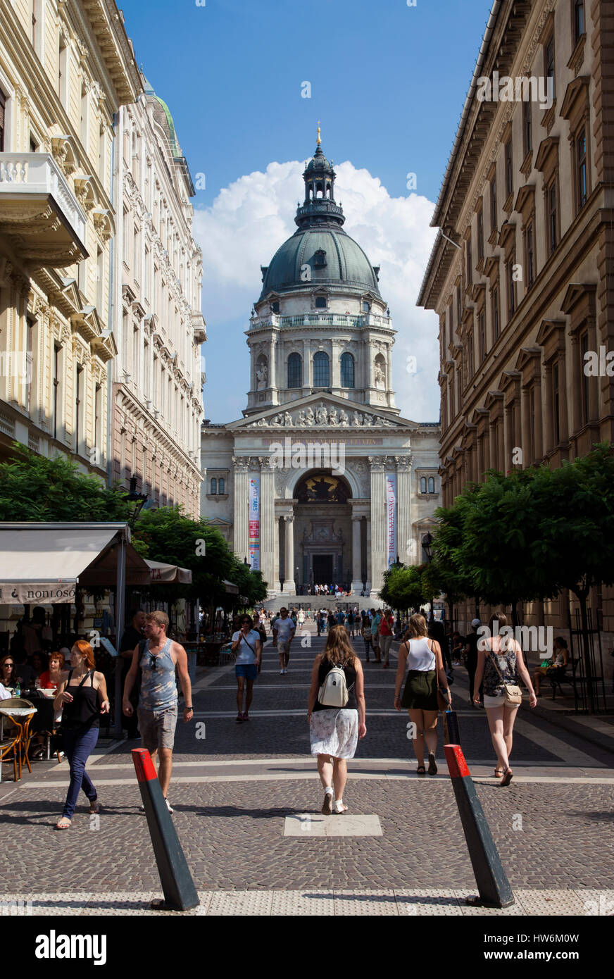 Tourists walking in Zrinyi street toward St Stephen basilica in the center of Budapest Stock Photo