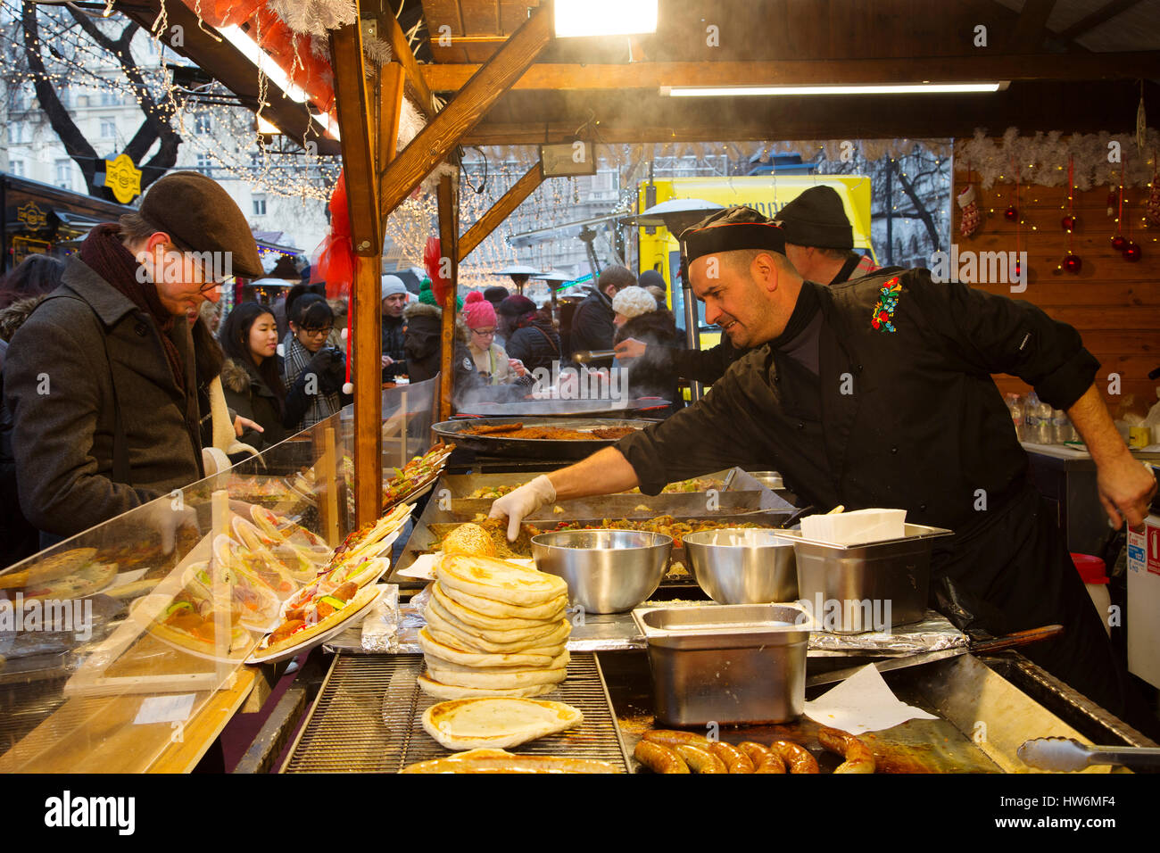 Weihnachtsmarkt Langos.Food A Man Cooking The Typical Langos Christmas Market Budapest