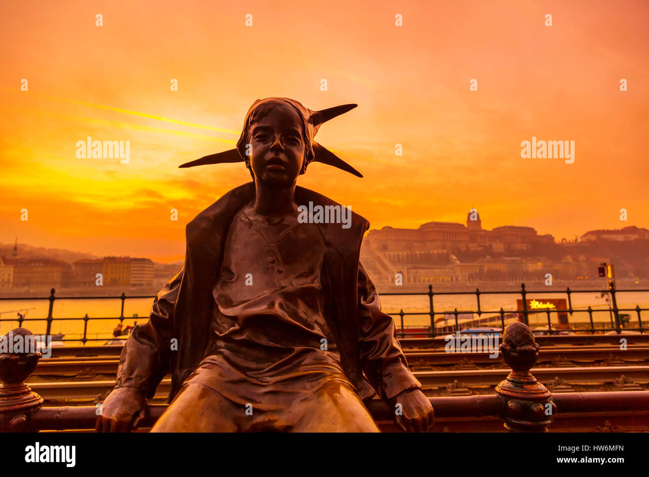 Harlequin statue near the Danube at sunset. Budapest Hungary, Southeast Europe - Stock Image