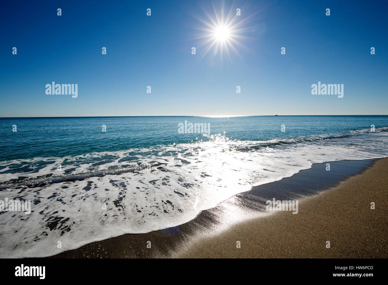 Beach on a sunny day, Marbella. Malaga province. Costa del Sol, Andalusia Southern Spain.Europe - Stock Image