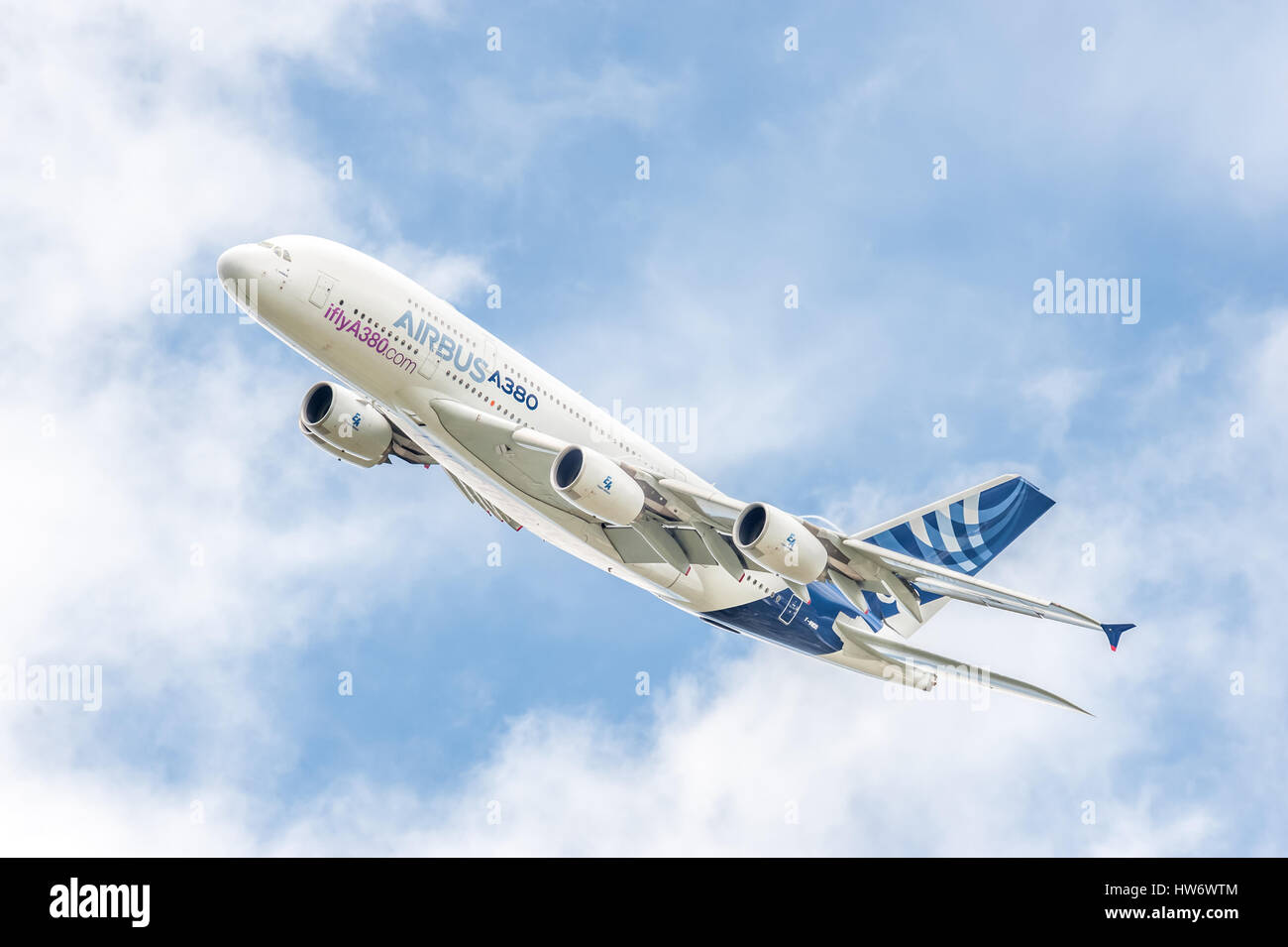 Airbus A380 on a low-level banked turn prior to landing at an aviation trade event. - Stock Image