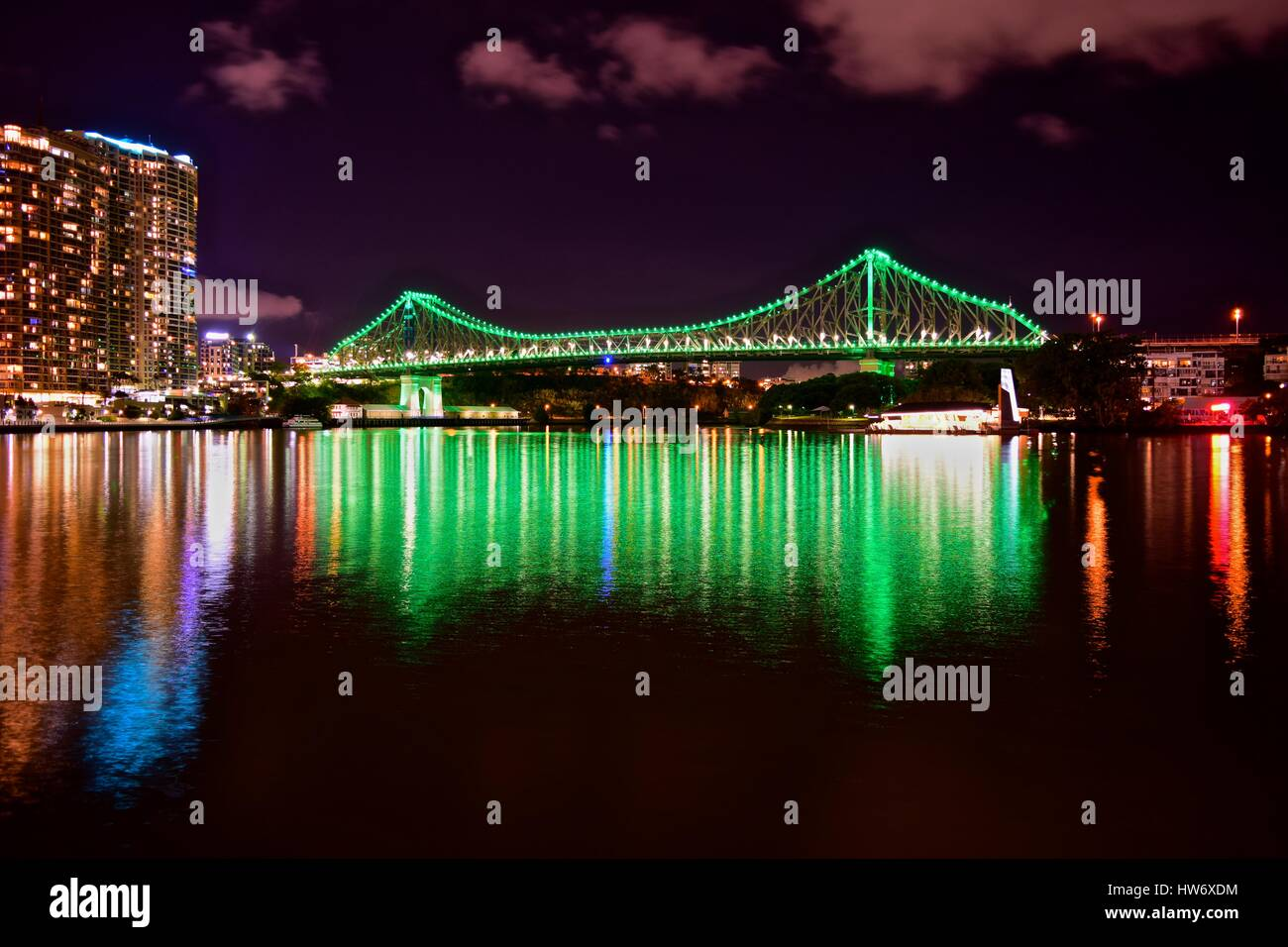 View of Story Bridge at night from across the Brisbane River. Photo captured using a long exposure. capturing the - Stock Image