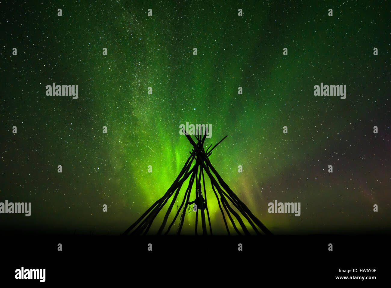 Northern lights behind a lavvo lavvu with stars in Finnmark Norway - Stock Image