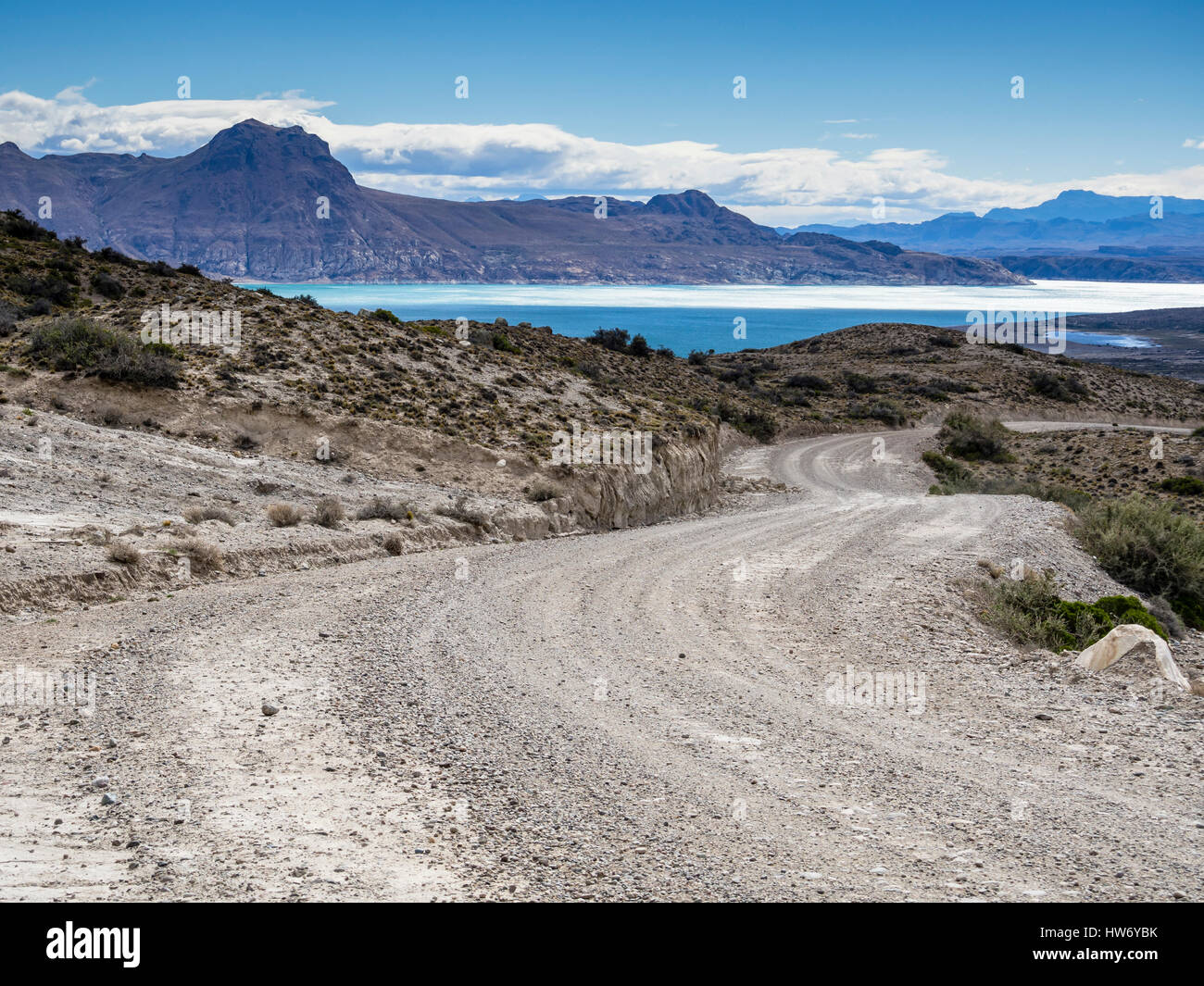 Gravel road from ruta 40 in Argentinia to border at Paso Roballos, lake Ghio, Patagonia, Argentinia - Stock Image