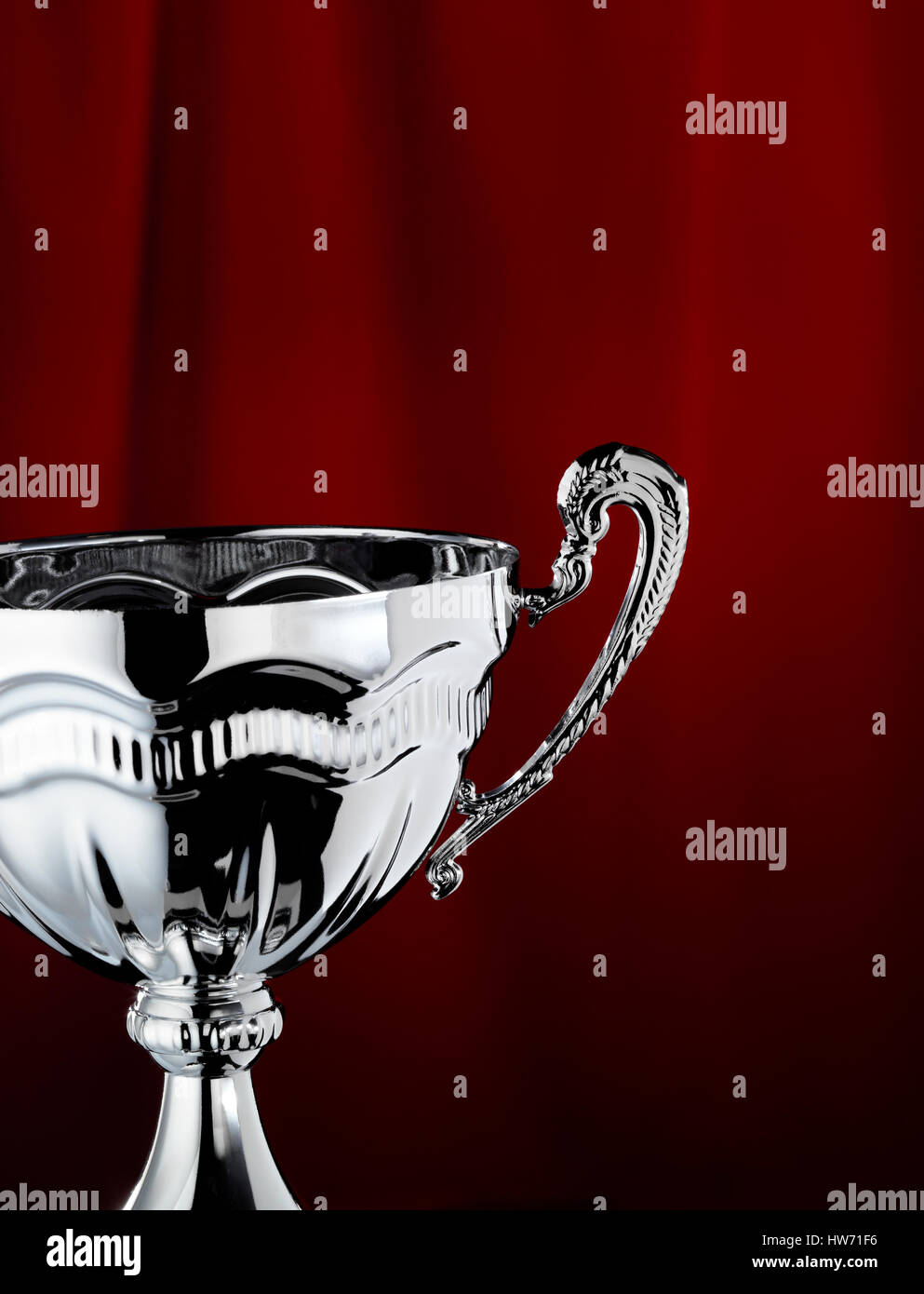 Trophy with a red curtain background - Stock Image