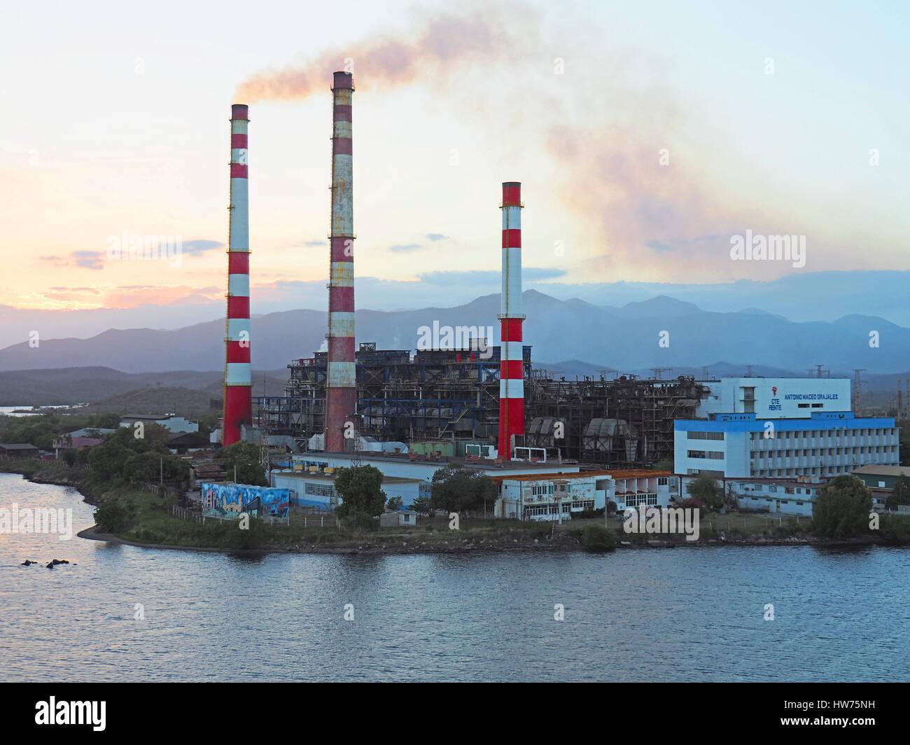 Refinery at Santiago de Cuba with air pollution problem. - Stock Image