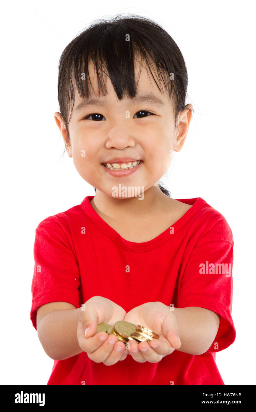 Asian Little Girl Holding Coins for Saving isloated on White Background - Stock Image