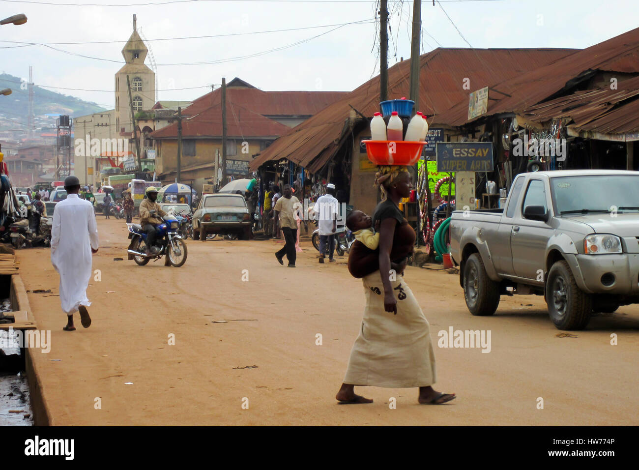 Street view with people and cars in the city of Lagos, the largest city in Nigeria and the African continent. - Stock Image