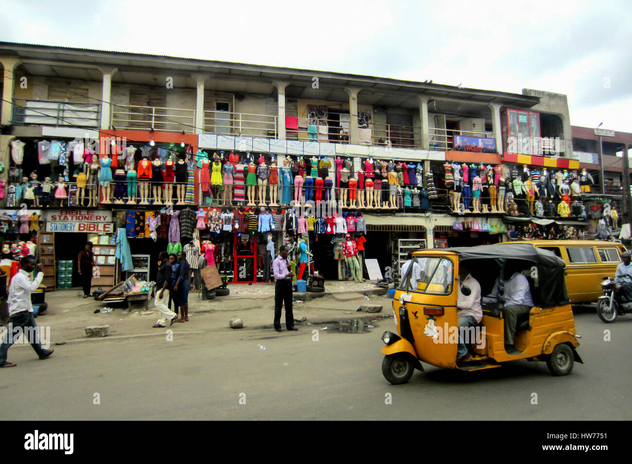 Colorful african fashion shops, with many clothes hanging in mannequins, in the large city of Lagos, Nigeria - Stock Image