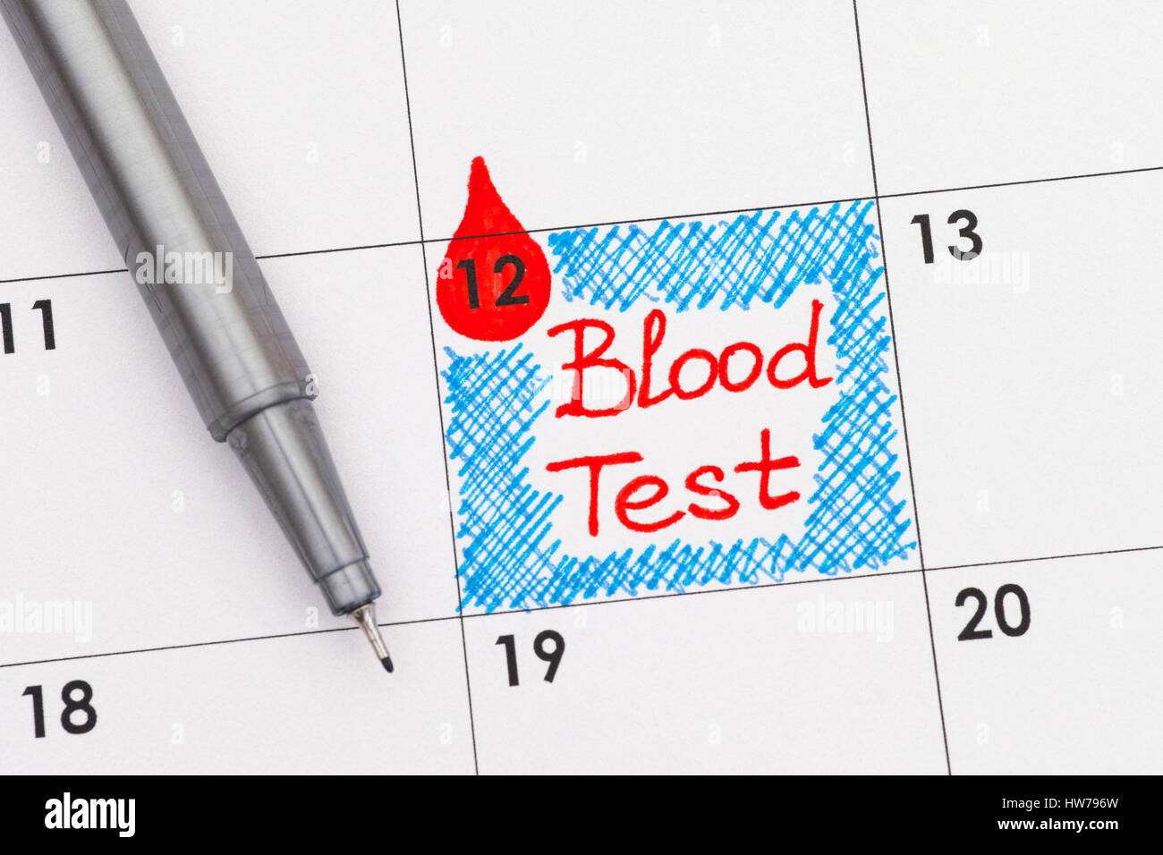 Reminder Blood Test in calendar with pen. Close-up. - Stock Image