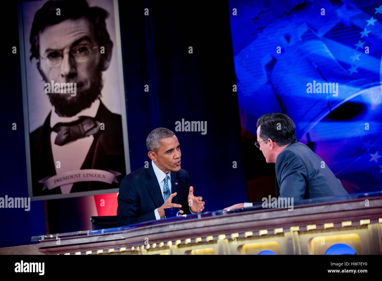 United States President Barack Obama left talks to television personality Stephen Colbert during taping of Comedy Stock Photo