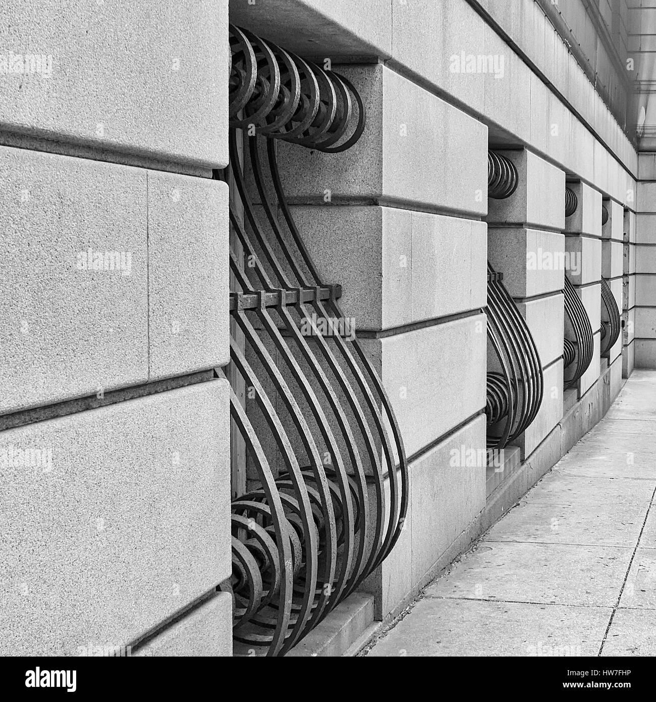 Ornate window bars on building - Stock Image