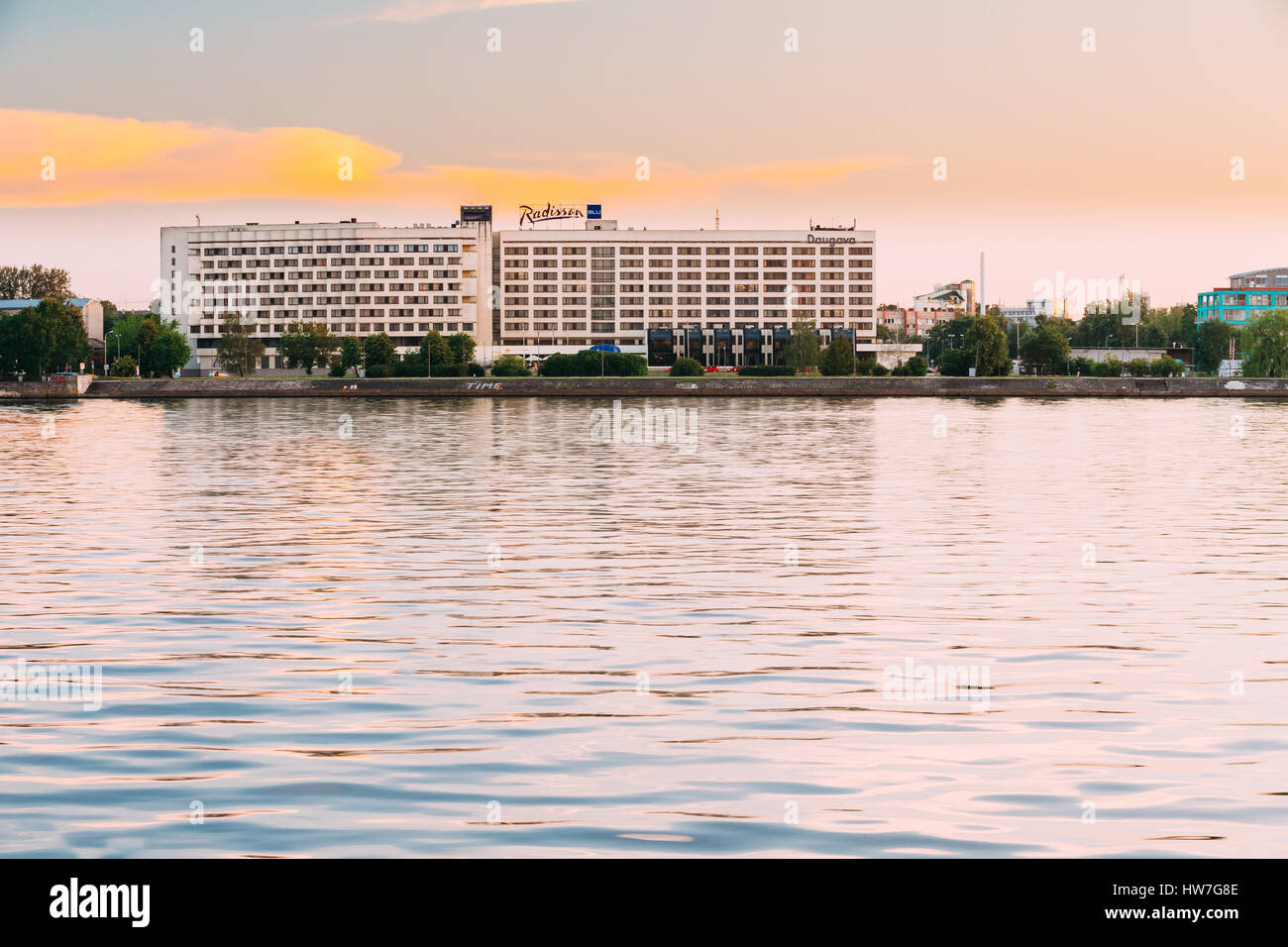 Riga, Latvia - July 1, 2016: Radisson Blu Hotel At Evening Sunset Time At Bank Of Daugava River. - Stock Image