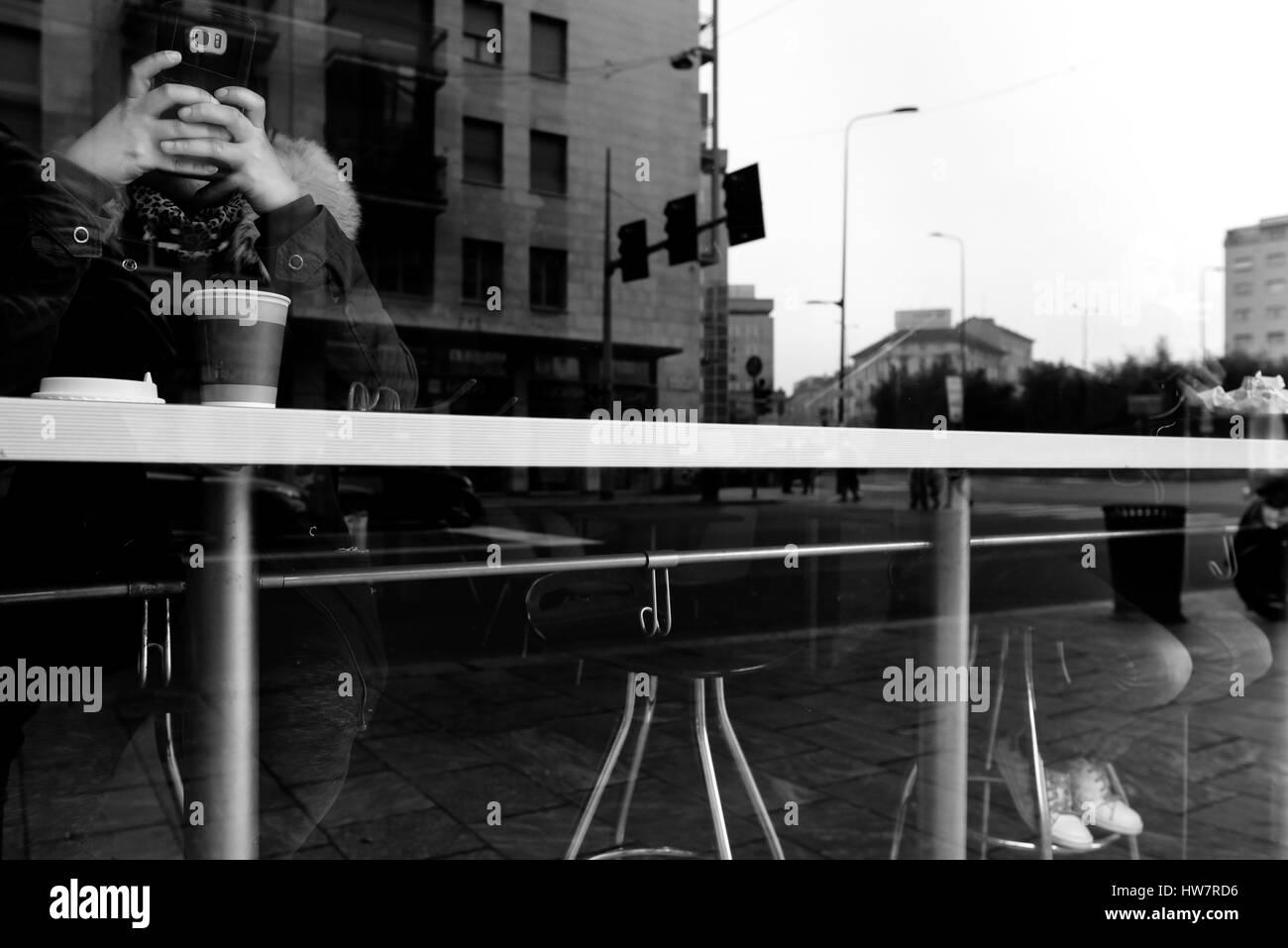 Window reflections. Mobile phone use - Stock Image