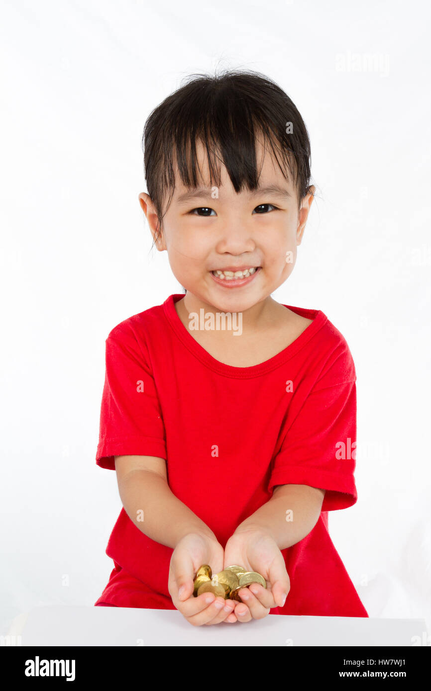 Asian Little Girl Holding Coins for Saving isloated on White Background Stock Photo
