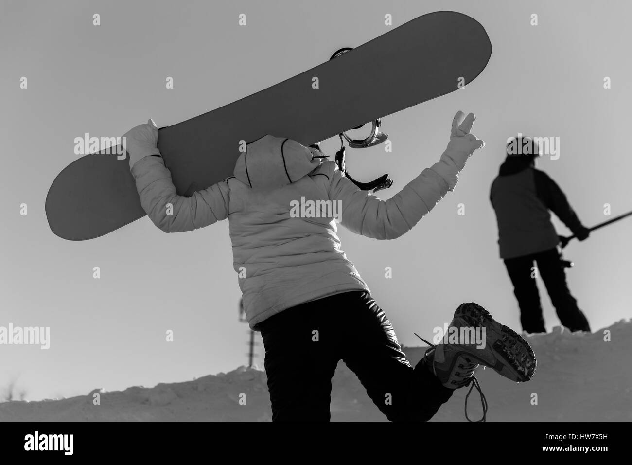 Girl running on mountain terrain - Stock Image